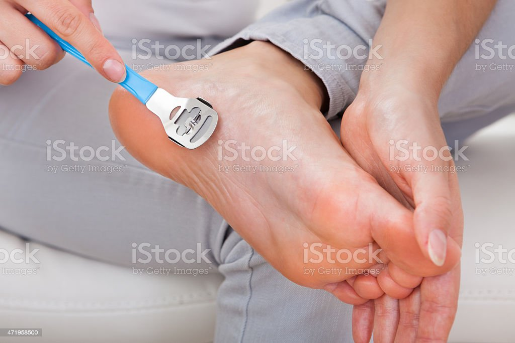 Woman having pedicure to her legs stock photo