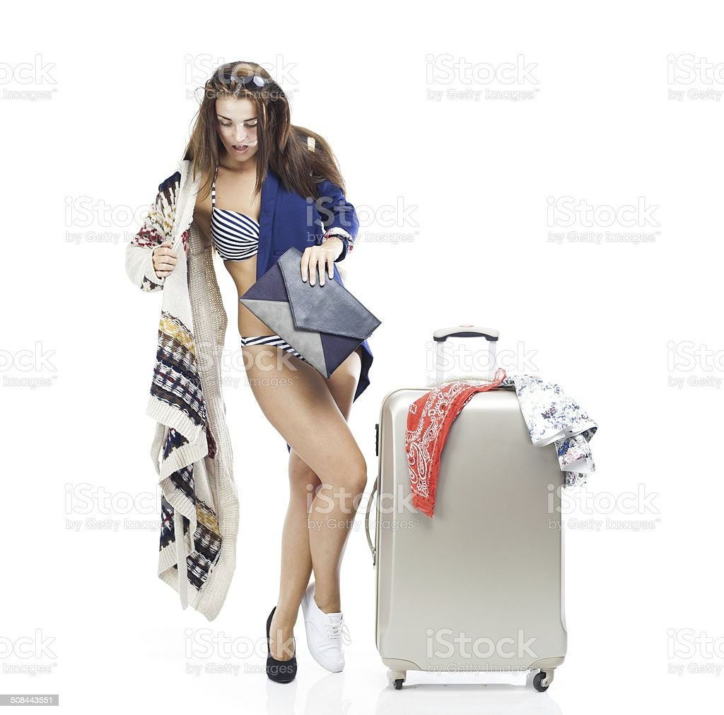 Woman having problem with packing suitcase stock photo