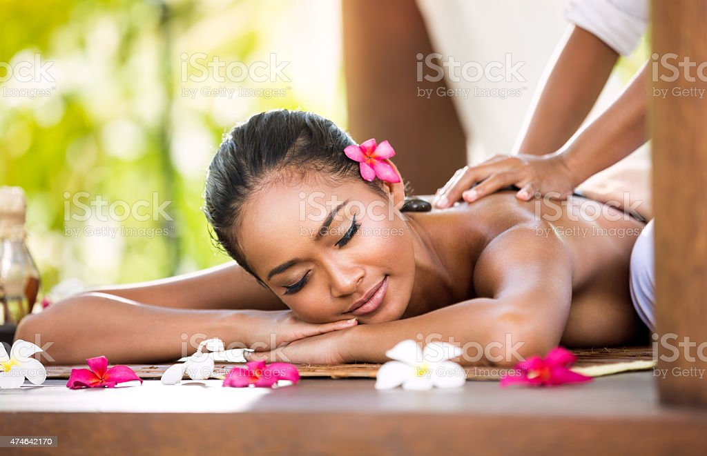 Woman having relaxing massage in spa salon stock photo