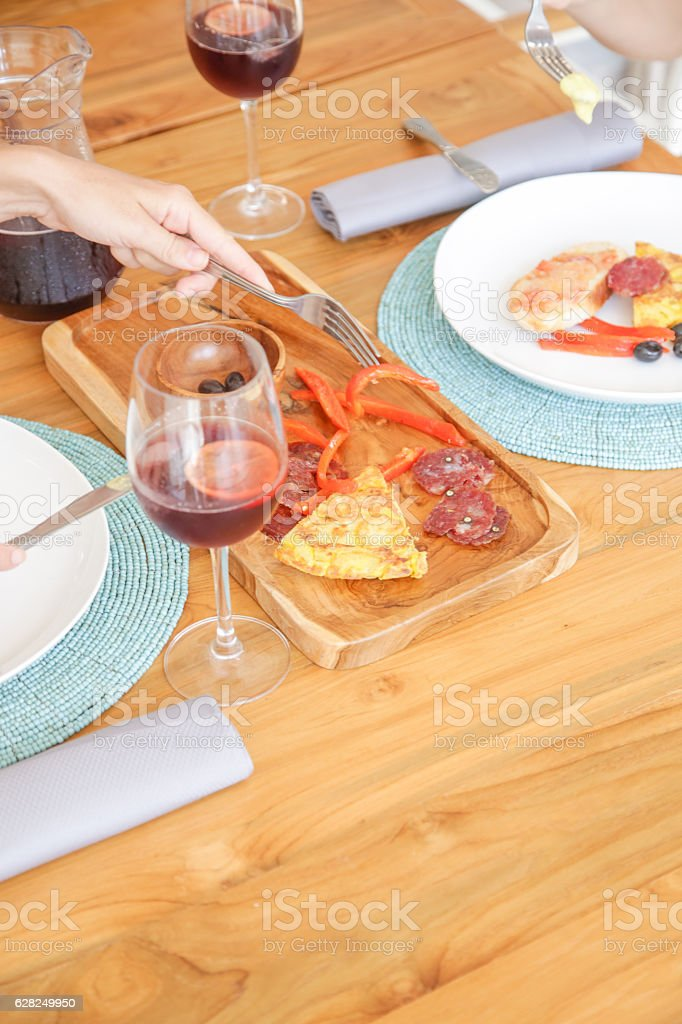 Woman having snack with a glass of sangria stock photo