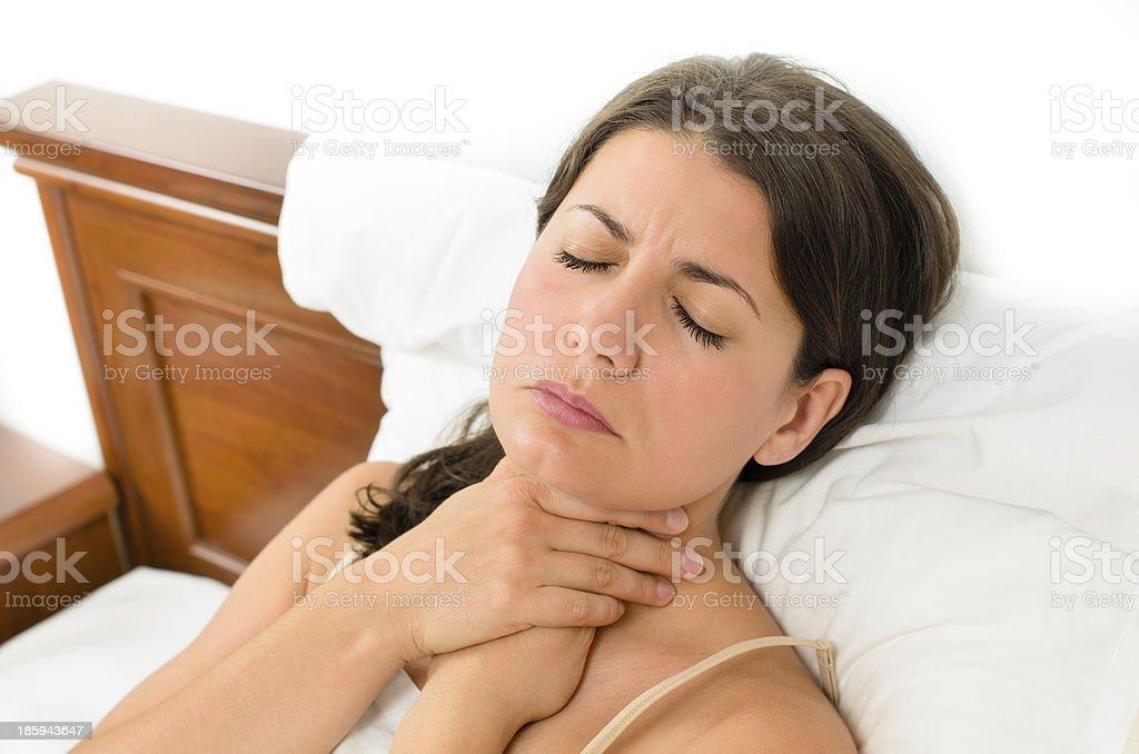 Woman having sore throat stock photo