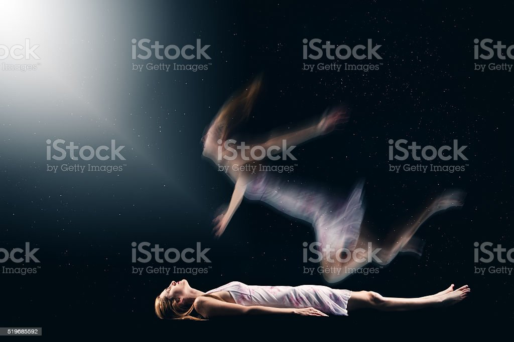 Woman Having Spiritual Out Of Body Experience stock photo