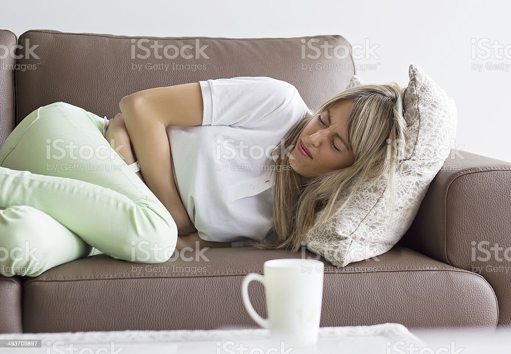 Woman having stomach pain stock photo