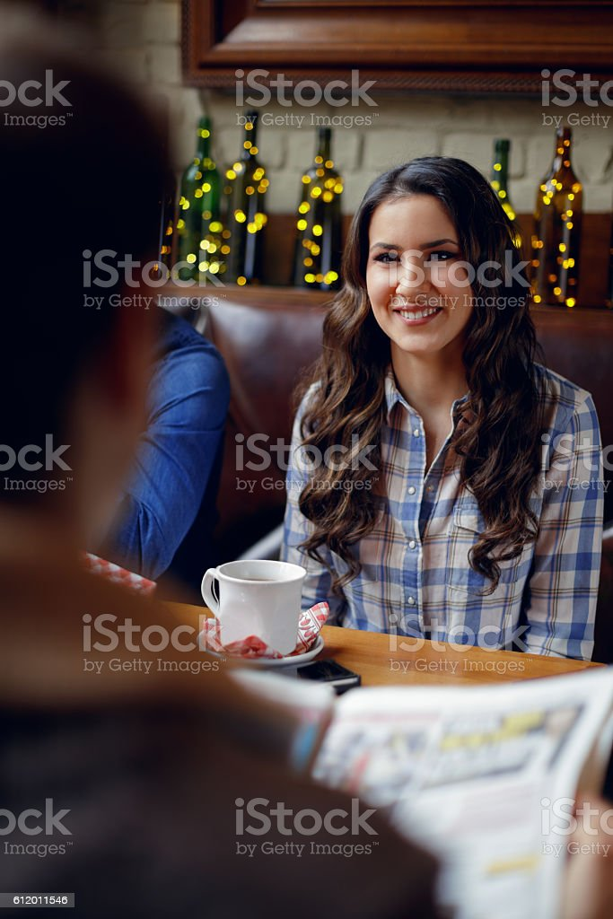 Woman having tea in cafe stock photo