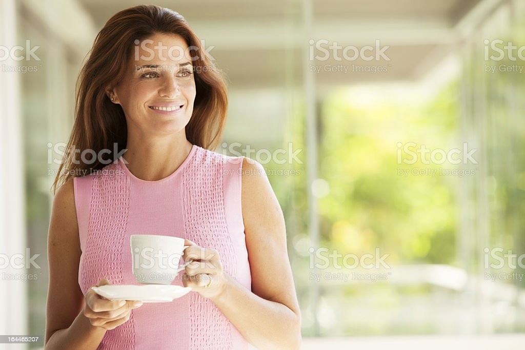 Woman Having Tea stock photo