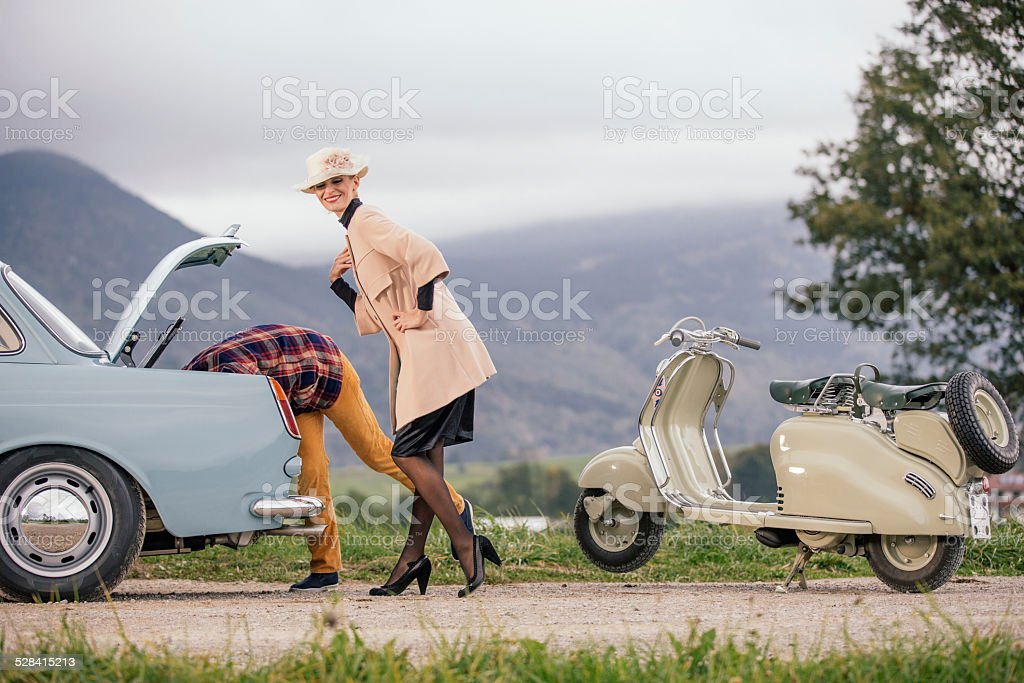 Woman having trouble with her car stock photo
