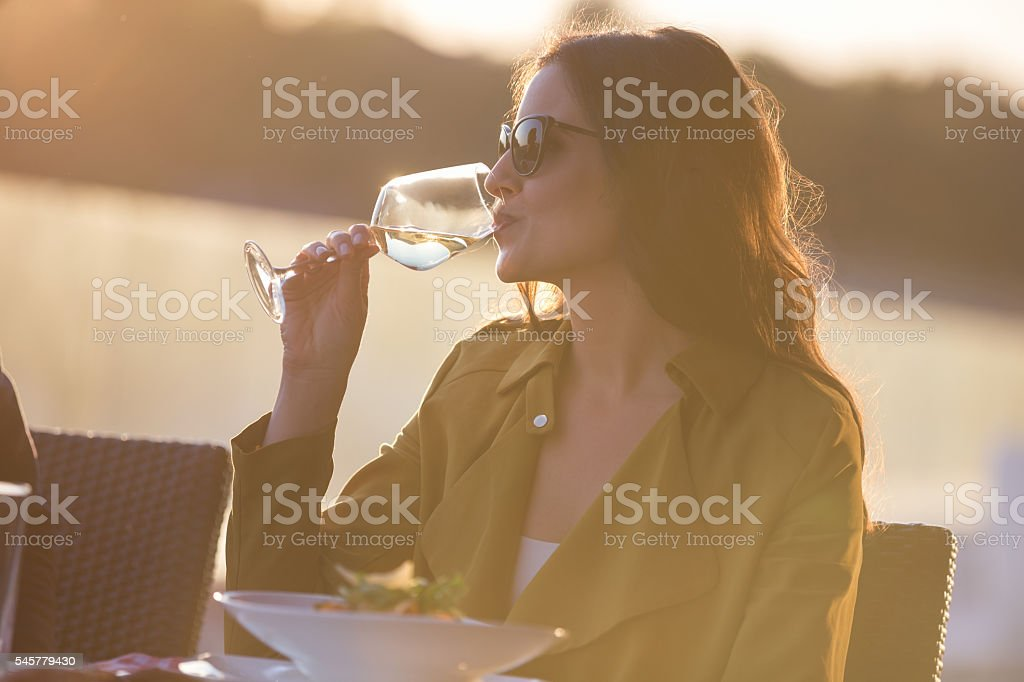 Woman having white wine stock photo