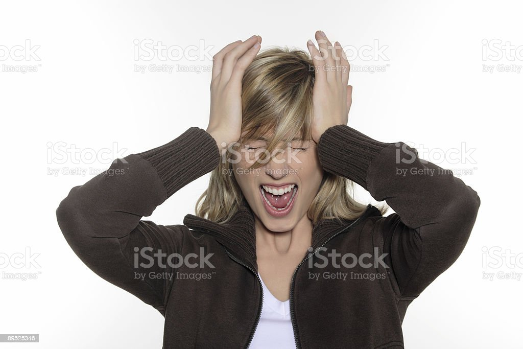 woman head in hands and shouting royalty-free stock photo