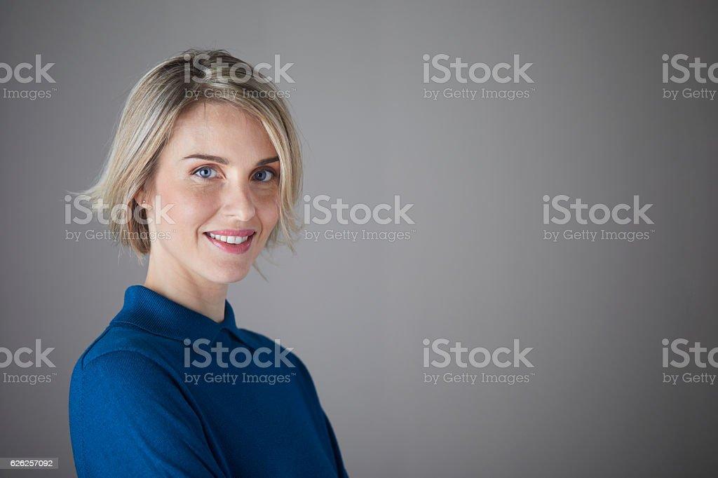 Woman headshot looking at camera. stock photo