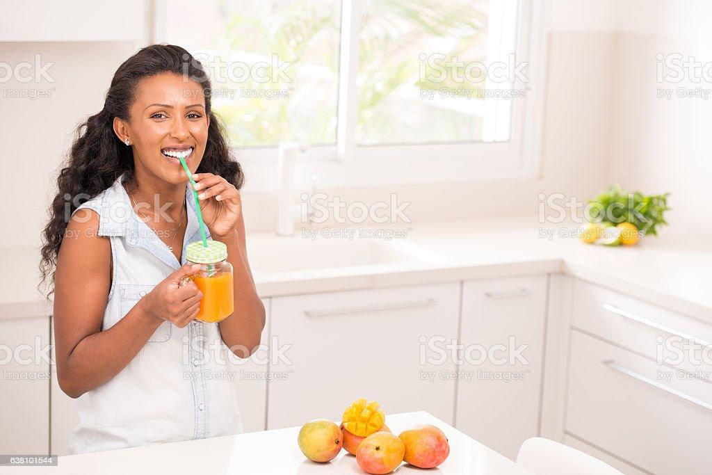 Woman healthy fruit drinks. stock photo