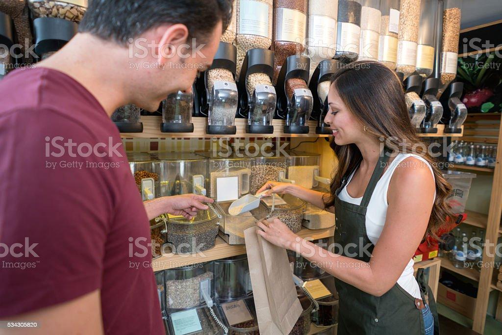 Woman helping customer at the supermarket stock photo