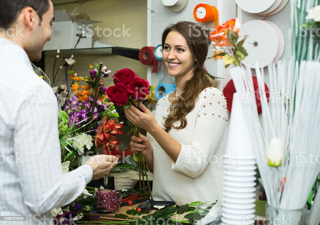 Woman  helping to pick  flowers man stock photo