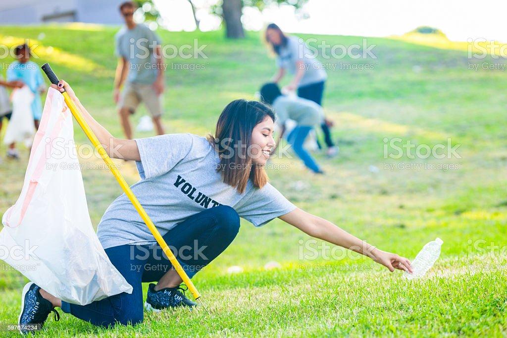 Woman helps neighbors clean up their neighborhood stock photo