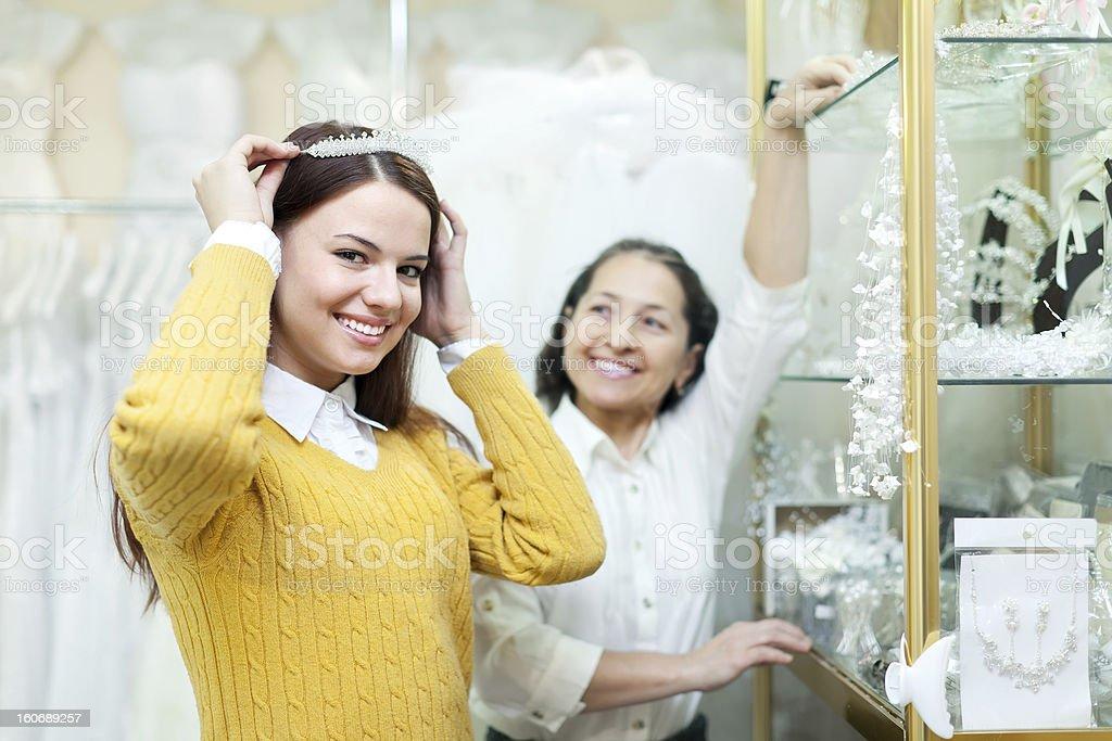 woman helps the bride in choosing bridal diadem royalty-free stock photo