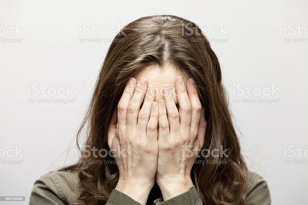 Woman Hides Face stock photo
