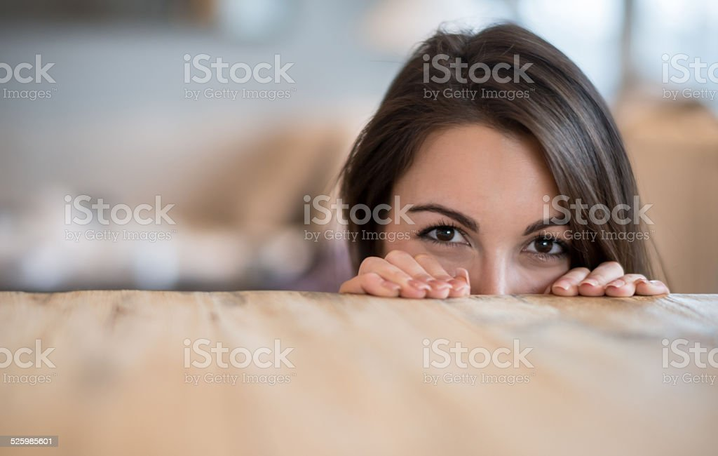 Woman hiding at home stock photo