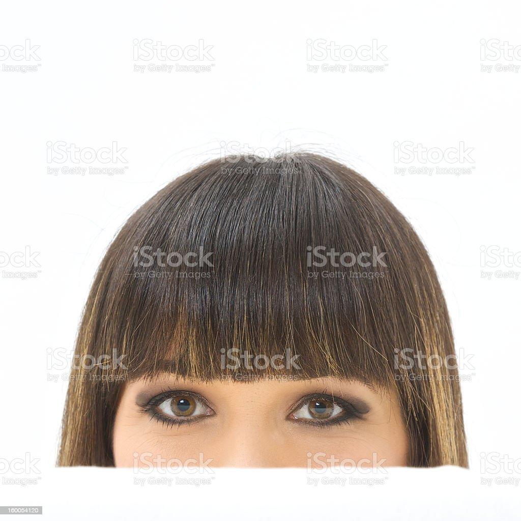 Woman hiding behind a white sofa royalty-free stock photo