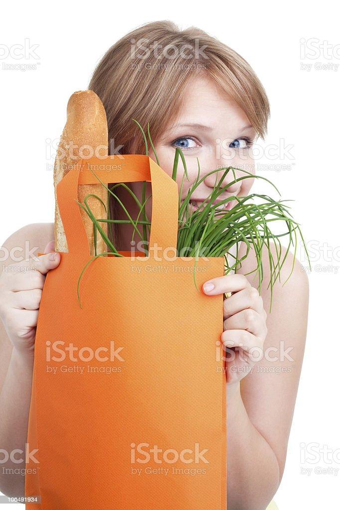 Woman hiding behind shopping bag stock photo
