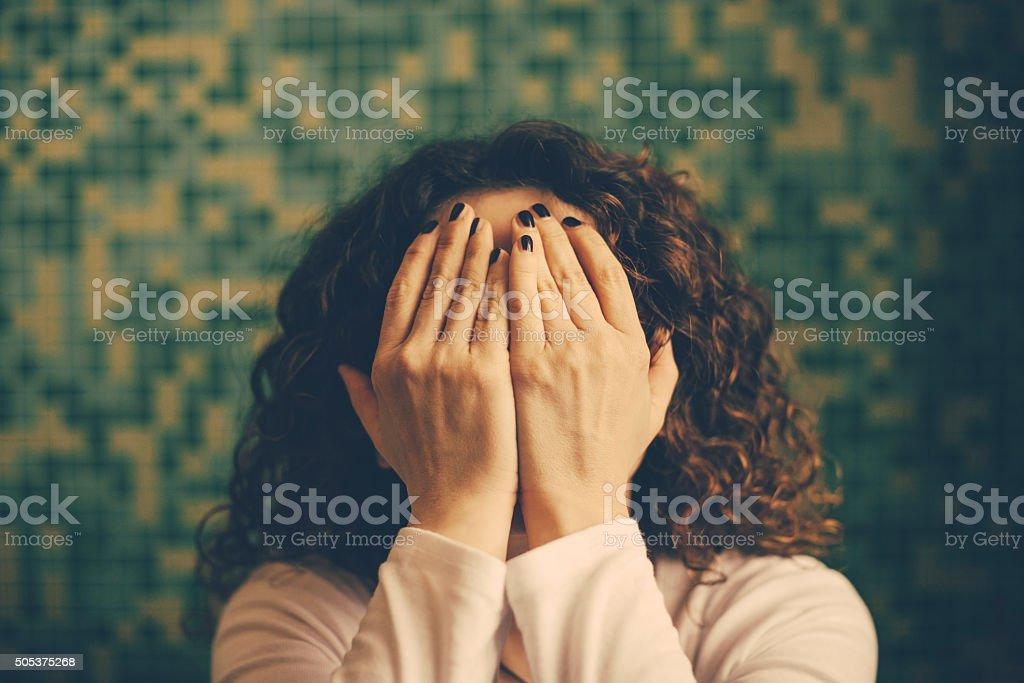 Woman hiding face stock photo