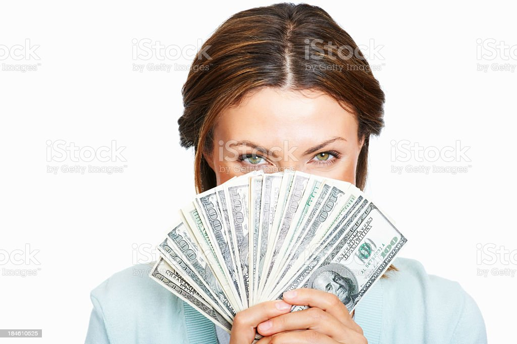 Woman hiding her face behind money royalty-free stock photo