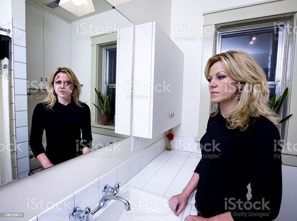 Woman Hiding That She is Abused royalty-free stock photo