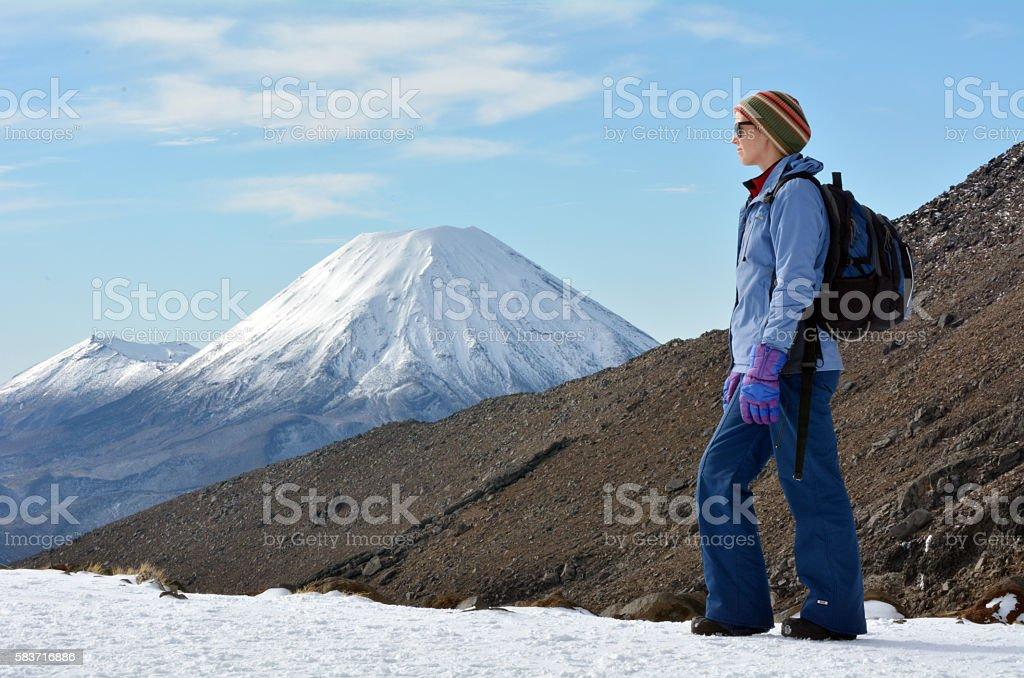 Woman hike the Tongariro crossing stock photo