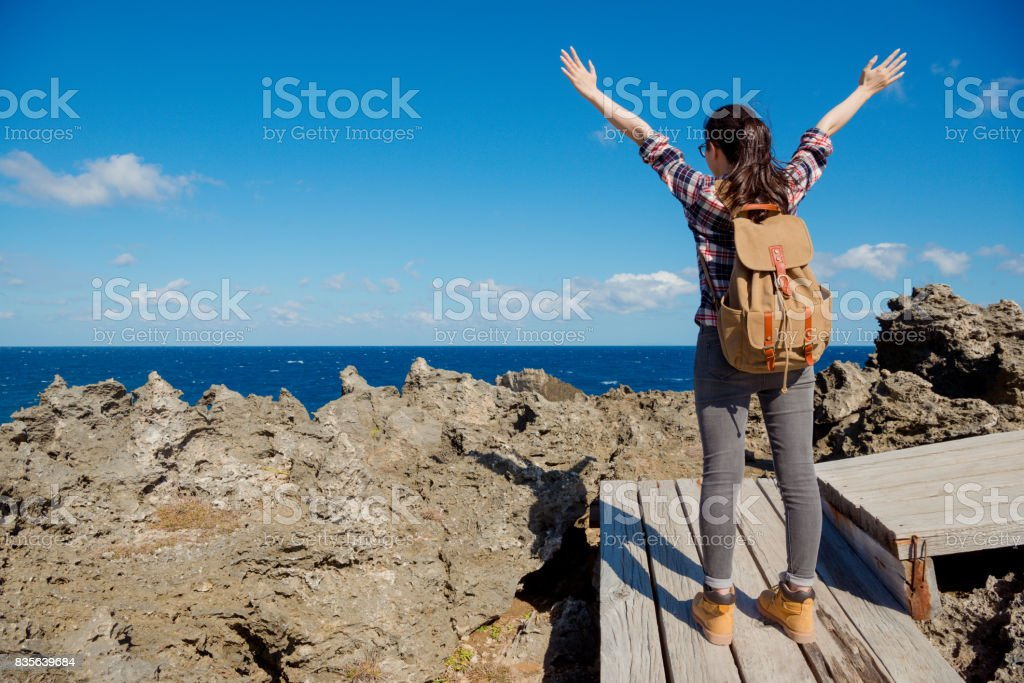 woman hiker cheering success and joy stock photo
