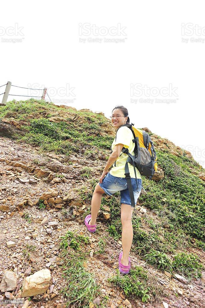 woman hiker climbing to mountain peak stock photo