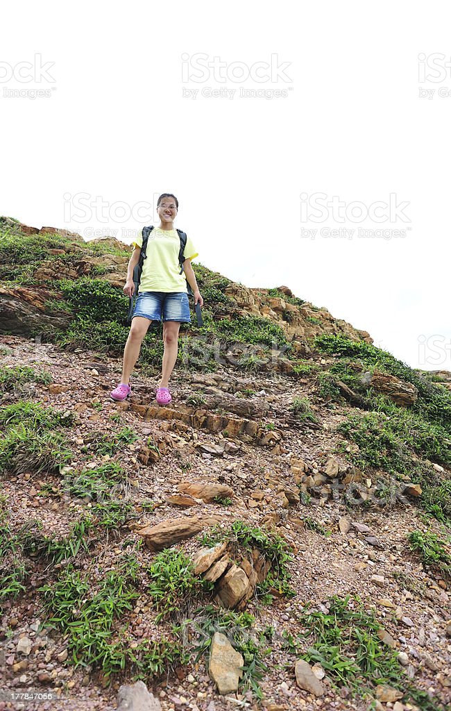 woman hiker climbing to mountain peak royalty-free stock photo