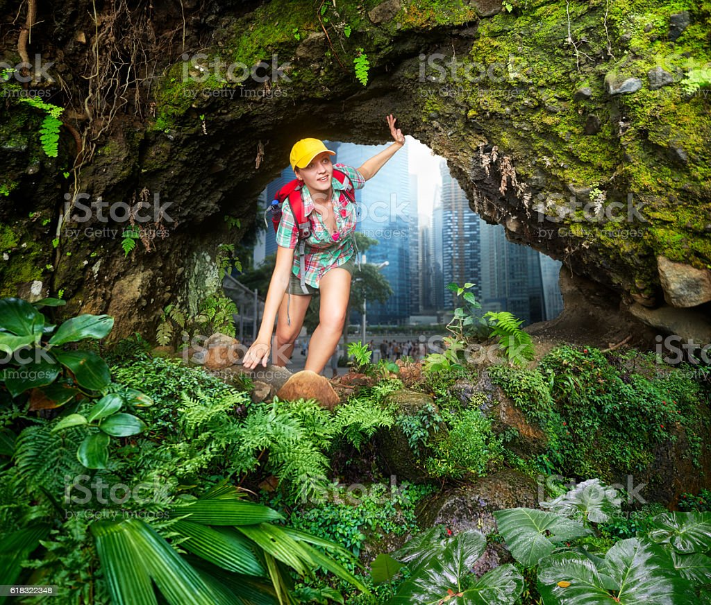 Woman hiker discovering a beautiful jungle stock photo
