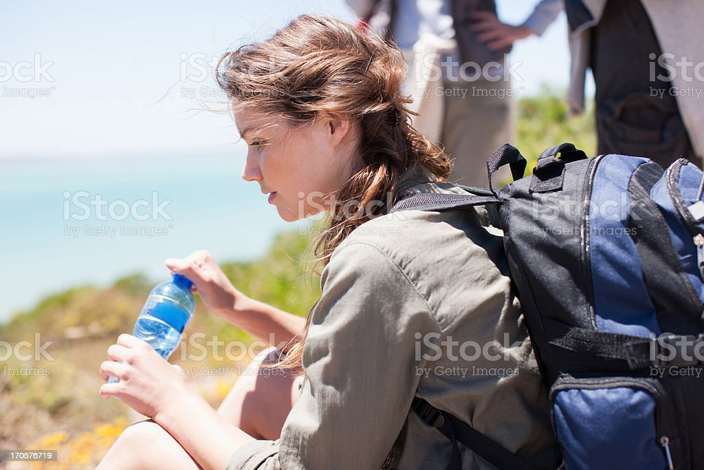 Woman hiker drinking water royalty-free stock photo
