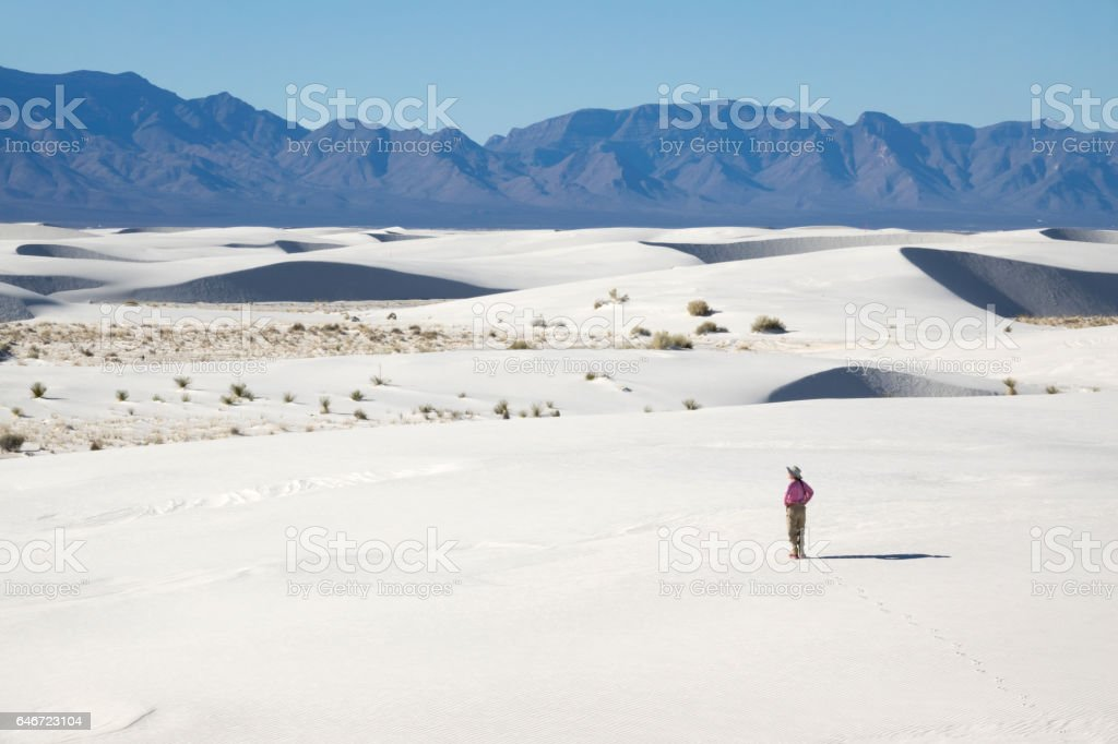 Woman hiker explores White Sands National Monument New Mexico mountains stock photo