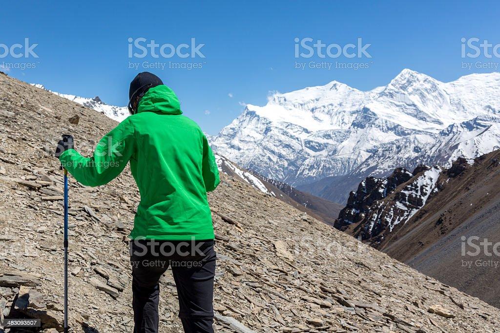 Woman hiker Hiking Around Annapurna Trek, Nepal royalty-free stock photo