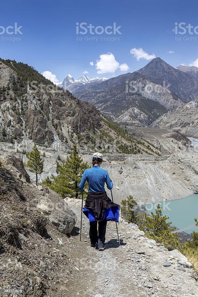 Woman hiker Hiking Around Annapurna Trek royalty-free stock photo