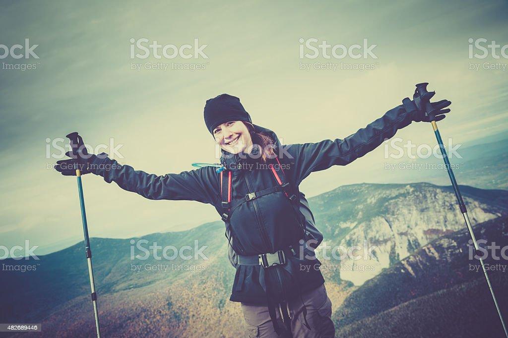 Woman Hiker Looking at Mountain Summit stock photo