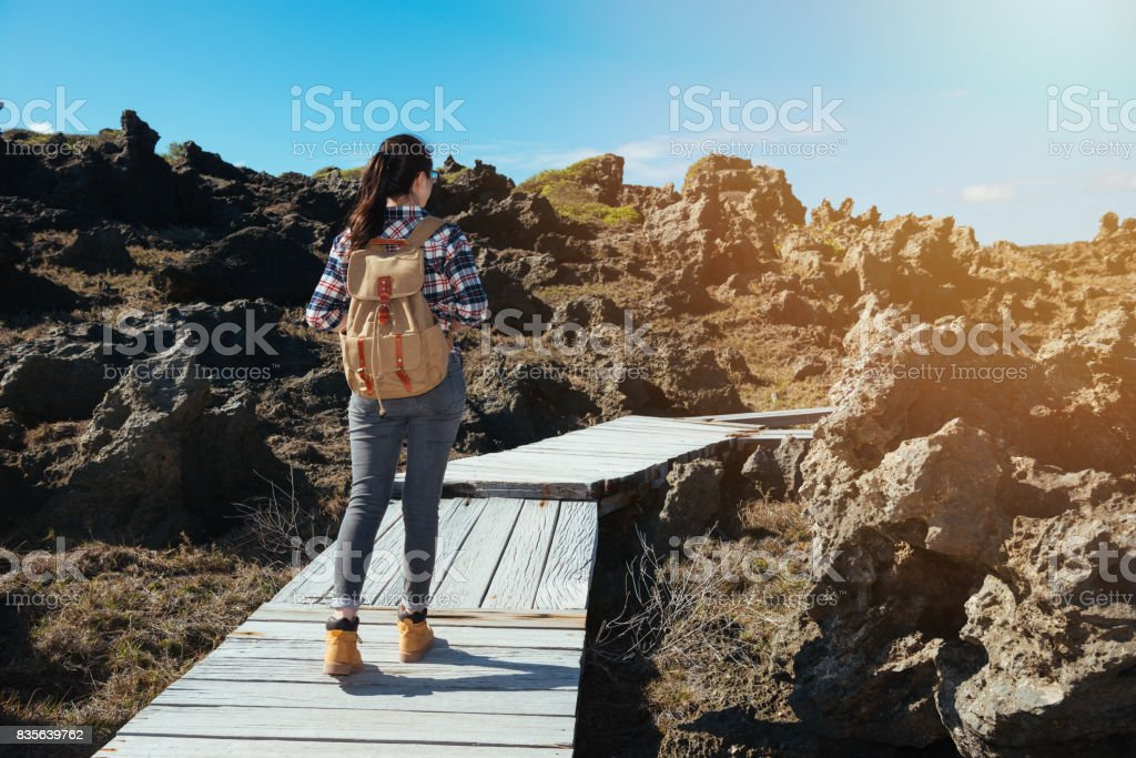 woman hiker looking view of beach stock photo