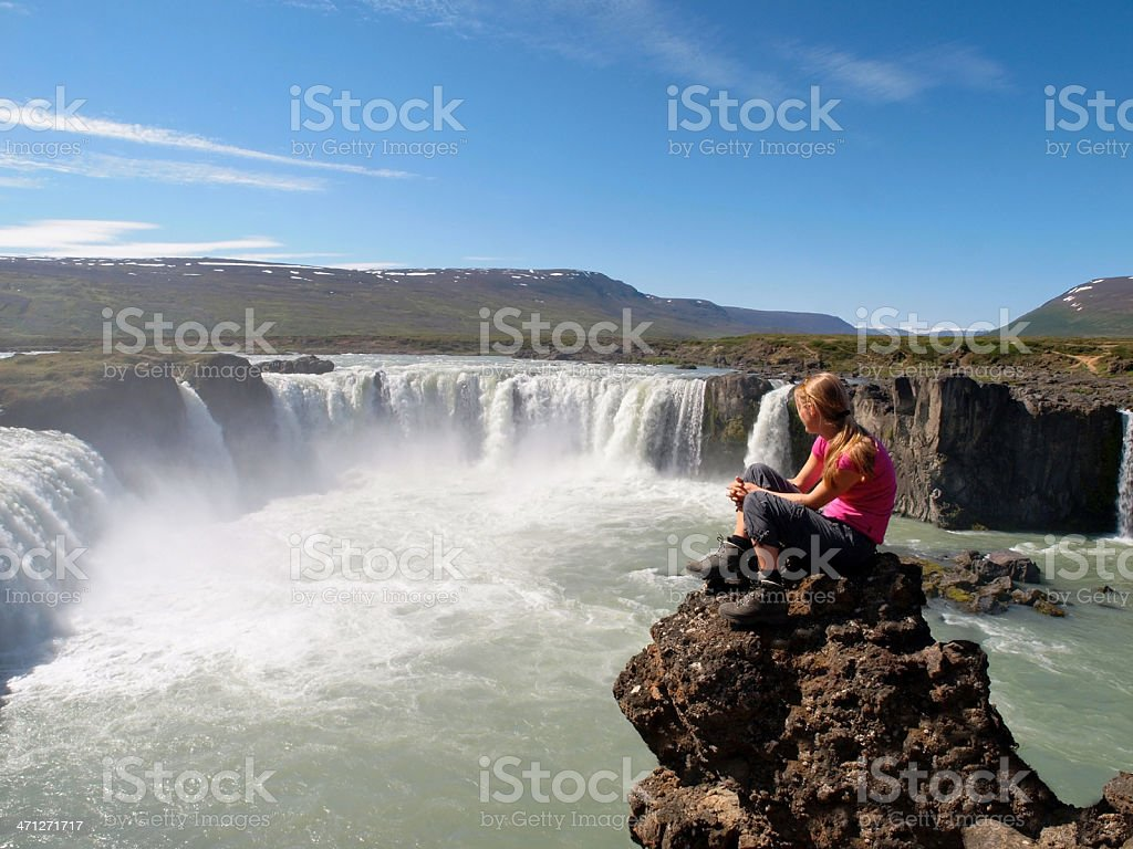 Woman Hiker resting At Godafoss Waterfall, Iceland. royalty-free stock photo
