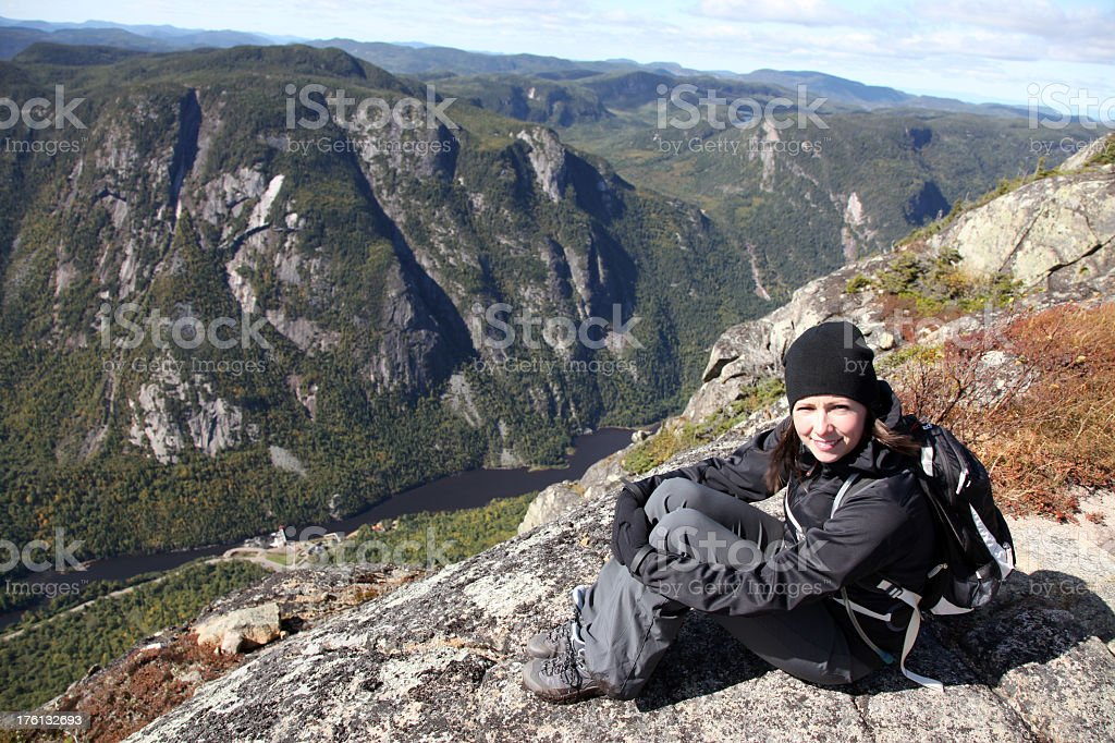 Woman Hiker Sitting on Mountain Summit stock photo