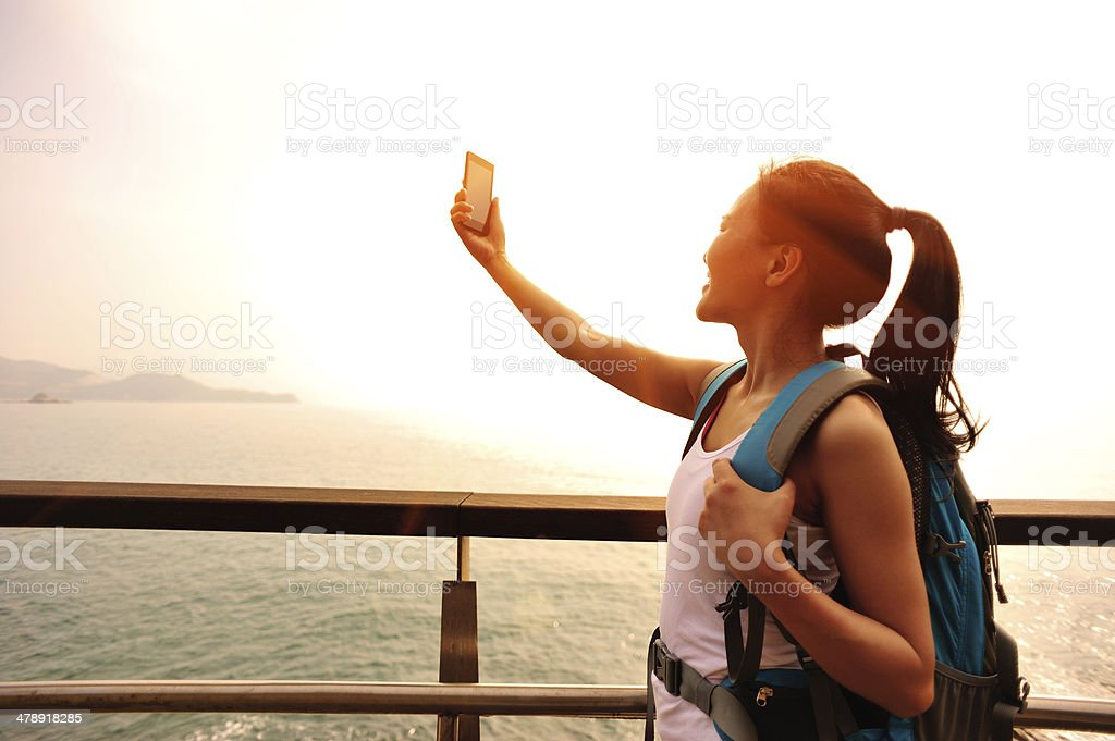 woman hiker use smart phone taking self photo seaside royalty-free stock photo