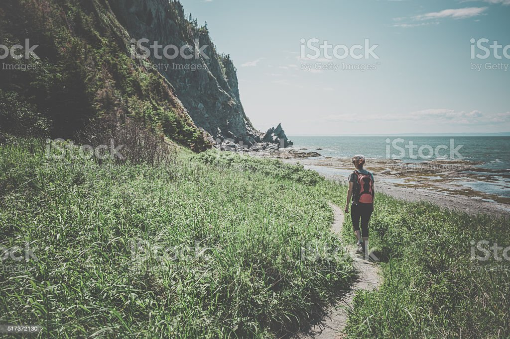 Woman Hiker Walking on a Trail stock photo