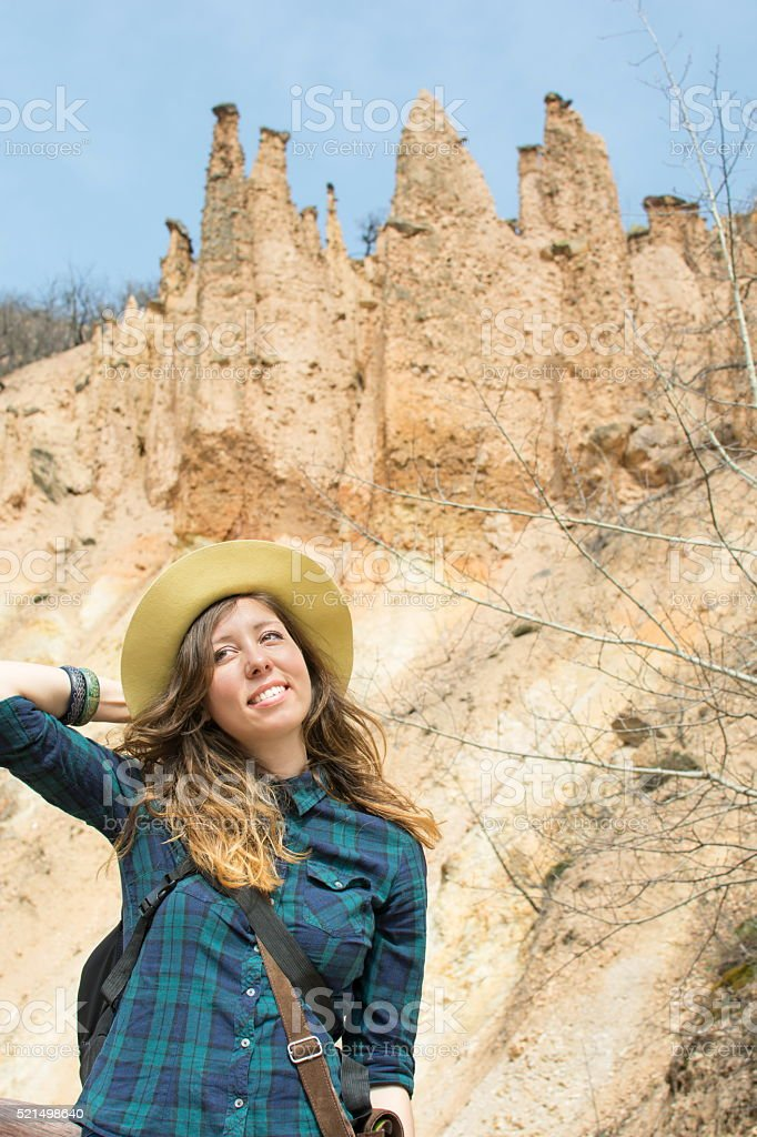 Woman hiker with backpack outdoors stock photo