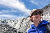 Woman Hiker with Mountain and Glacier Background