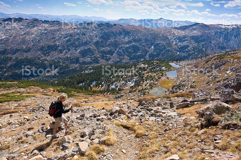 Woman Hiking Above Alpine Lakes stock photo