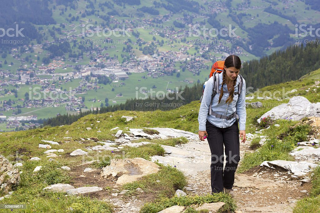 Woman Hiking above town stock photo