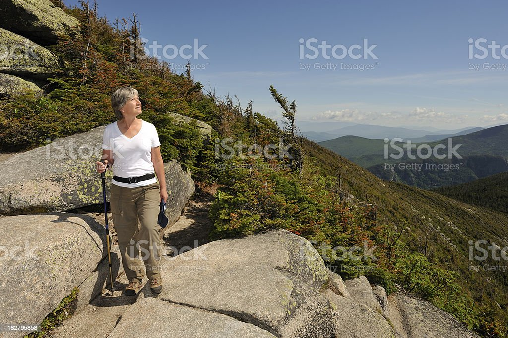 Woman hiking and looking at sun on beautiful day royalty-free stock photo