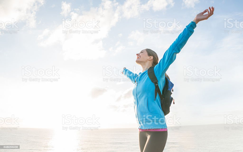 Woman hiking and looking very happy stock photo