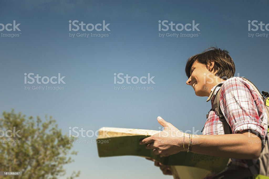 woman hiking and reading a map royalty-free stock photo