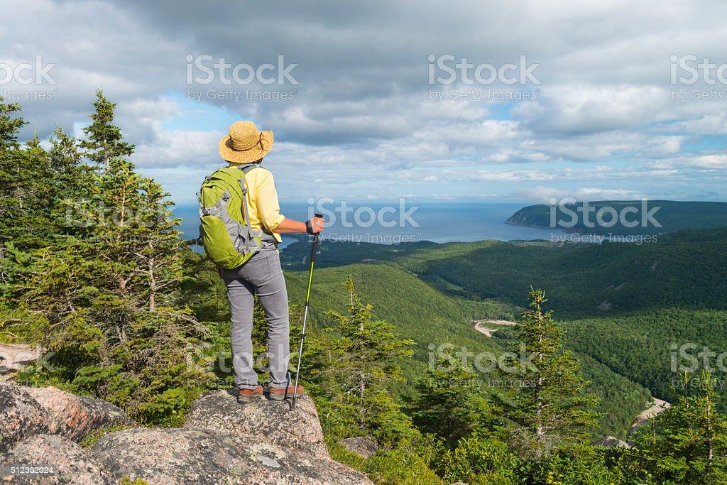 Woman hiking, Cabot trail, Cape Breton, Nova Scotia, Canada, Maritime stock photo