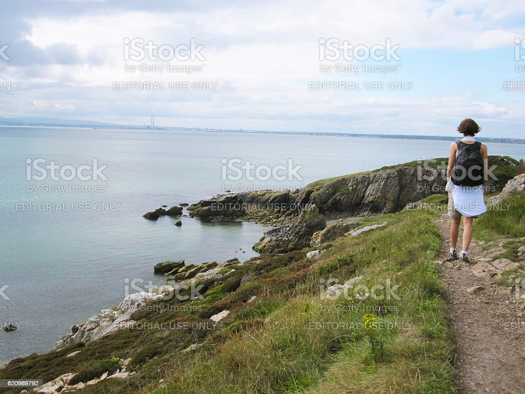 Woman hiking in Howth in Ireland stock photo