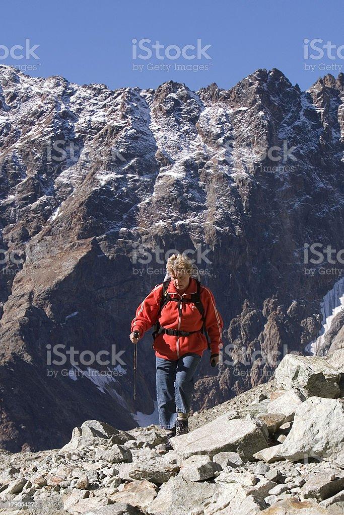Woman hiking in Italian mountains royalty-free stock photo